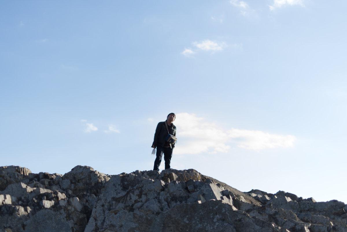 岩に登るおじさん(友人)